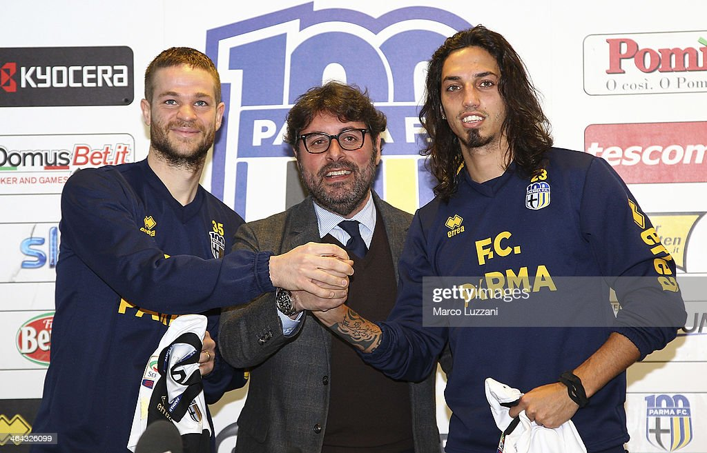 <a gi-track='captionPersonalityLinkClicked' href=/galleries/search?phrase=Jonathan+Rossini&family=editorial&specificpeople=5780827 ng-click='$event.stopPropagation()'>Jonathan Rossini</a>, General Manager for Parma FC Pietro Leonardi and Ezequiel Schelotto are presented as new signings for Parma FC during a press conference at the club's training ground on on January 22, 2014 in Collecchio, Italy.