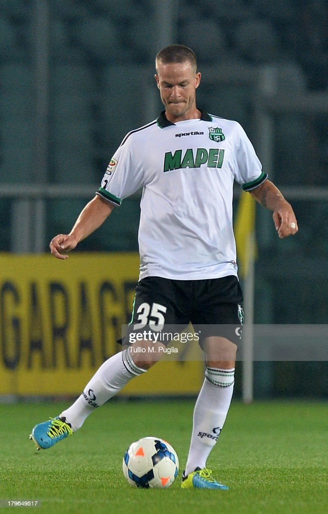 <a gi-track='captionPersonalityLinkClicked' href=/galleries/search?phrase=Jonathan+Rossini&family=editorial&specificpeople=5780827 ng-click='$event.stopPropagation()'>Jonathan Rossini</a> of Sassuolo in action during the Serie A match between Torino FC and US Sassuolo Calcio at Stadio Olimpico di Torino on August 25, 2013 in Turin, Italy.