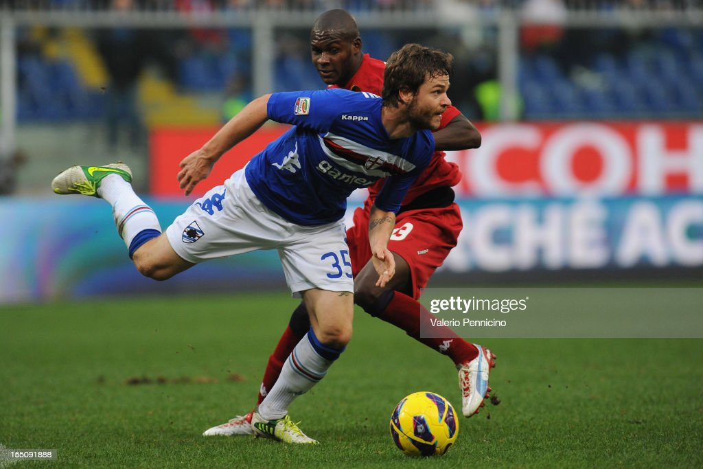<a gi-track='captionPersonalityLinkClicked' href=/galleries/search?phrase=Jonathan+Rossini&family=editorial&specificpeople=5780827 ng-click='$event.stopPropagation()'>Jonathan Rossini</a> (L) of UC Sampdoria in action against Victor Ibarbo of Cagliari Calcio during the Serie A match between UC Sampdoria and Cagliari Calcio at Stadio Luigi Ferraris on October 28, 2012 in Genoa, Italy.
