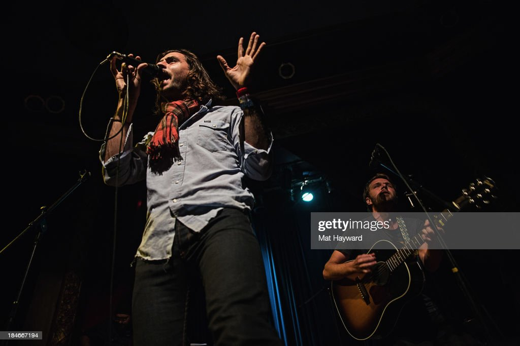 Jonathan Russell and Josiah Johnson of Head and the Heart perform on stage at the Columbia City Theater on October 14, 2013 in Seattle, Washington.
