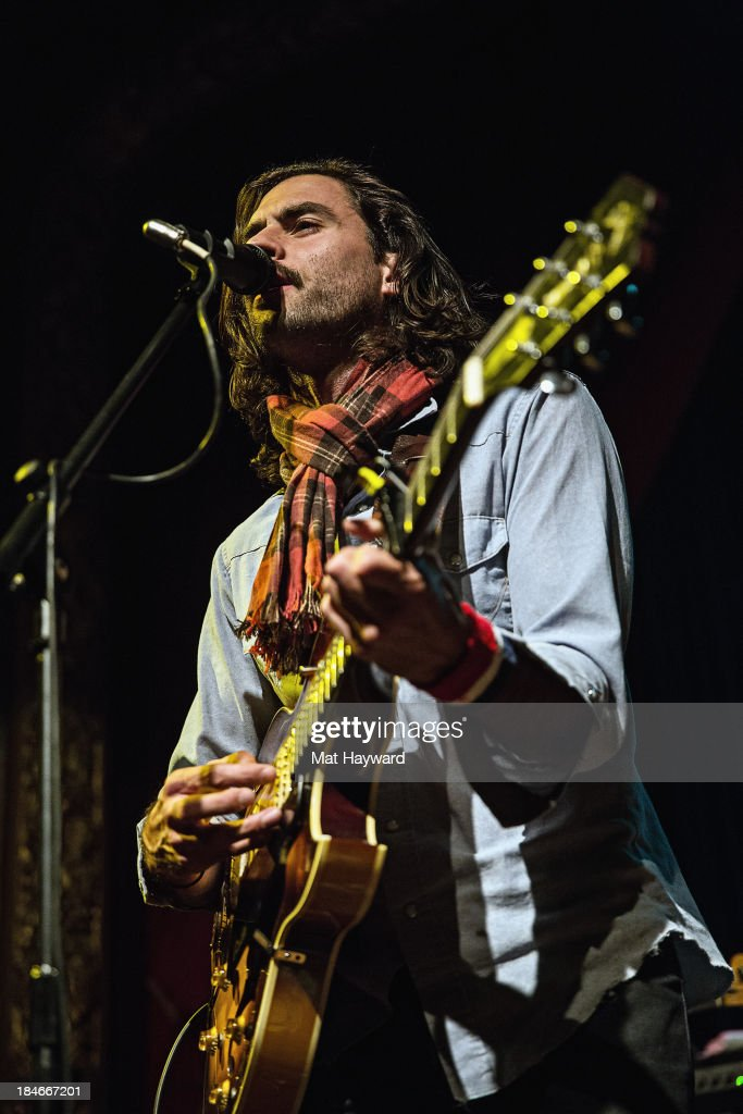 Jonathan Russell of Head and the Heart performs on stage at the Columbia City Theater on October 14, 2013 in Seattle, Washington.