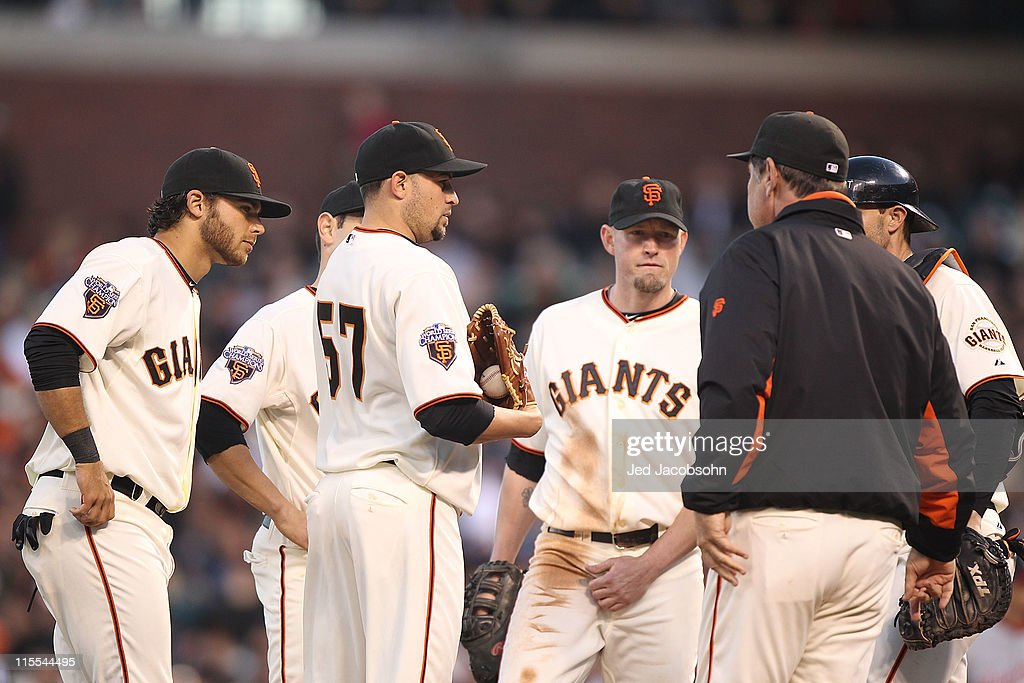 Jonathan Sanchez #57 of the San Francisco Giants talks with manager <a gi-track='captionPersonalityLinkClicked' href=/galleries/search?phrase=Bruce+Bochy&family=editorial&specificpeople=220291 ng-click='$event.stopPropagation()'>Bruce Bochy</a> in the fourth inning against the Washington Nationals during an MLB game at AT&T Park on June 7, 2011 in San Francisco, California.