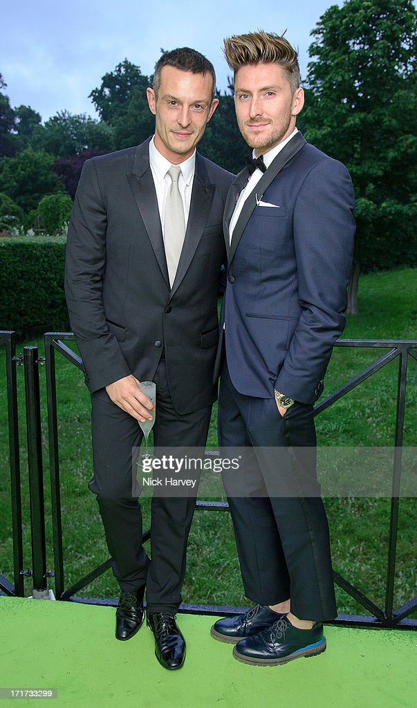 Jonathan Saunders and Henry Holland (R)attends the 15th Annual White Tie and Tiara Ball to Benefit Elton John AIDS Foundation in Association with Chopard at Woodside on June 27, 2013 in Windsor, England. No sales to online/digital media worldwide until the 14th of July. No sales before July 14th, 2013 in UK, Spain, Switzerland, Mexico, Dubai, Russia, Serbia, Bulgaria, Turkey, Argentina, Chile, Peru, Ecuador, Colombia, Venezuela, Puerto Rico, Dominican Republic, Greece, Canada, Thailand, Indonesia, Morocco, Malaysia, India, Pakistan, Nigeria. All pictures are for editorial use only and mention of 'Chopard' and 'The Elton John Aids Foundation' are compulsory. No sales ever to Ok, Now, Closer, Reveal, Heat, Look or Grazia magazines in the United Kingdom. No sales ever to any jewellers or watchmakers other than Chopard.