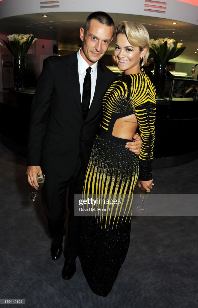 Jonathan Saunders (L) and <a gi-track='captionPersonalityLinkClicked' href=/galleries/search?phrase=Rita+Ora&family=editorial&specificpeople=5686485 ng-click='$event.stopPropagation()'>Rita Ora</a> arrive at the GQ Men of the Year awards at The Royal Opera House on September 3, 2013 in London, England.