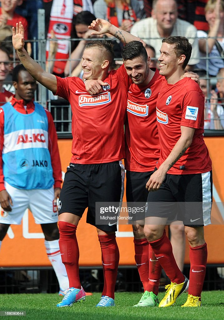 Jonathan Schmid (L) celebrates his goal with team-mates Daniel Caligiuri (C) and <a gi-track='captionPersonalityLinkClicked' href=/galleries/search?phrase=Max+Kruse&family=editorial&specificpeople=3945507 ng-click='$event.stopPropagation()'>Max Kruse</a> of Freiburg during the Bundesliga match between SC Freiburg and FC Augsburg at MAGE SOLAR Stadium on May 5, 2013 in Freiburg, Germany.