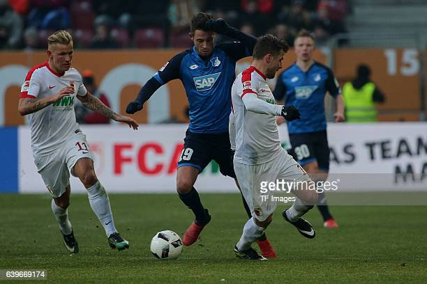 Jonathan Schmid of Augsburg Mark Uth of 1899 Hoffenheim and Daniel Baier of Augsburg battle for the ball during the Bundesliga match between FC...