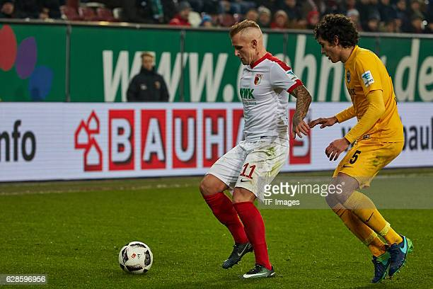 Jonathan Schmid of Augsburg und Jesus Vallejo of Frankfurt battle for the ball during the Bundesliga match between FC Augsburg and Eintracht...