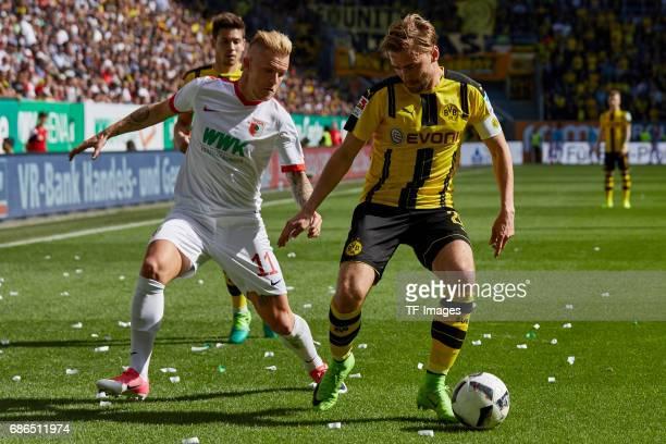 Jonathan Schmid of Augsburg und Marcel Schmelzer of Dortmund battle for the ball during the Bundesliga match between FC Augsburg and Borussia...