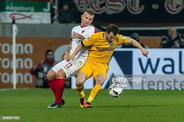 Jonathan Schmid of Augsburg und Szabolcs Huszti of Frankfurt battle for the ball during the Bundesliga match between FC Augsburg and Eintracht...