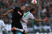 Jonathan Schmid of Freiburg and Thorben Marx of Moenchengladbach go up for a header during the Bundesliga match between VfL Borussia Moenchengladbach...