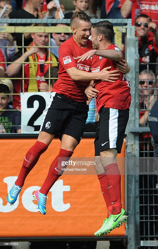 Jonathan Schmid of Freiburg (L) celebrates his goal with Daniel Caligiuri during the Bundesliga match between SC Freiburg and FC Augsburg at MAGE SOLAR Stadium on May 5, 2013 in Freiburg, Germany.