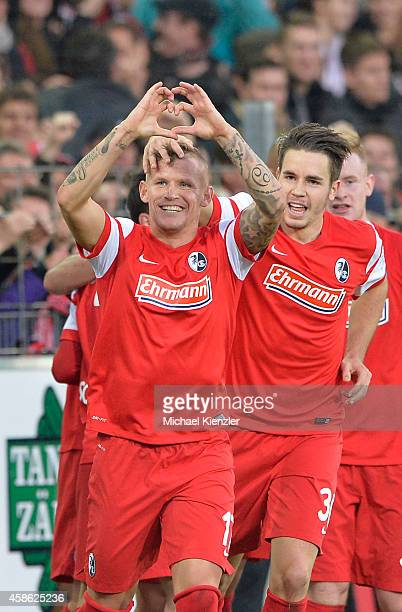 Jonathan Schmid of Freiburg celebrates with Christian Guenter after scoring their second goal during the Bundesliga match between SC Freiburg and FC...