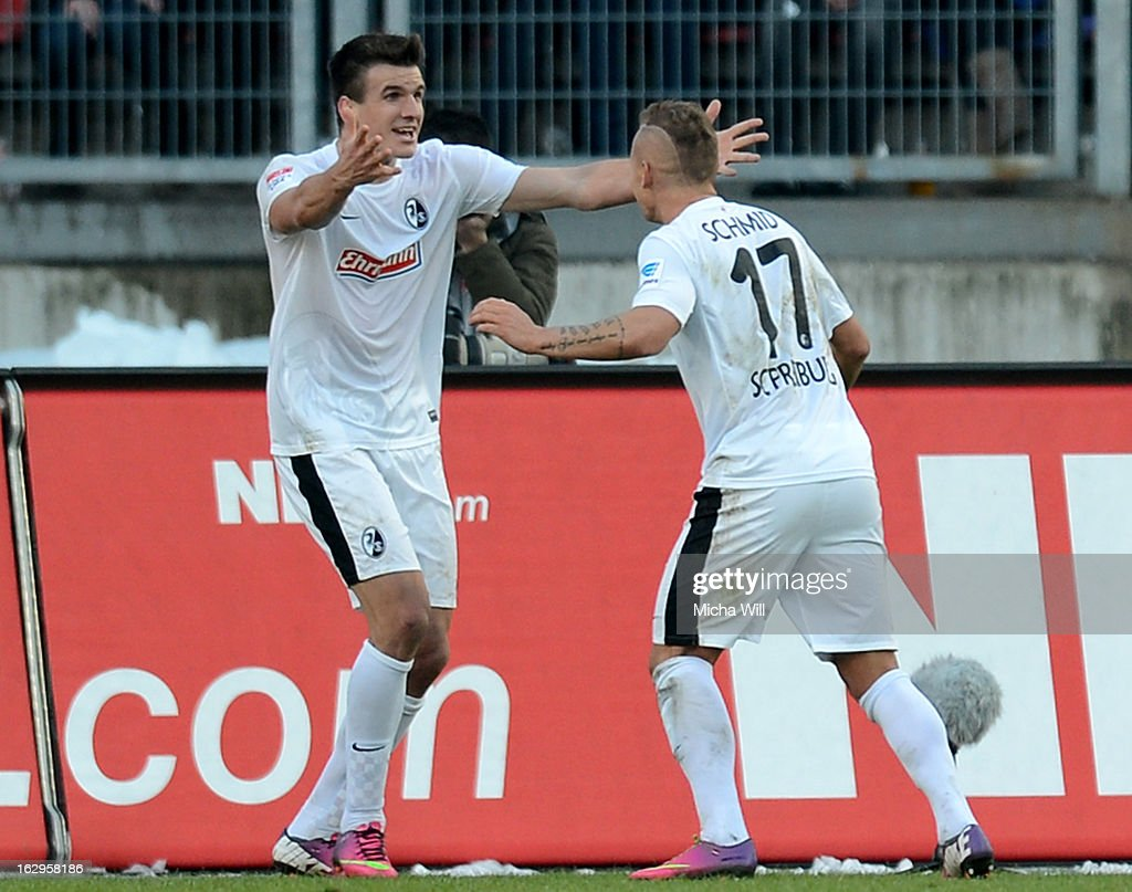 Jonathan Schmid (r) of Freiburg celebrates with Ivan Santini of Freiburg after scoring his team's first goal during the Bundesliga Match between 1. FC Nuernberg and SC Freibug at Grundig Stadion on March 2, 2013 in Nuremberg, Germany.