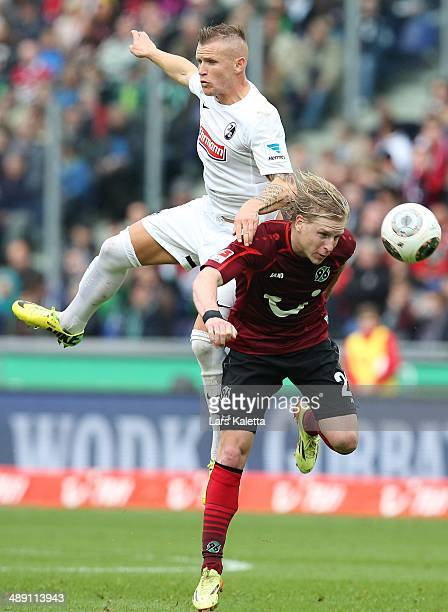 Jonathan Schmid of Freiburg fights for the ball with Frantisek Rajtoral of Hanover during the Bundesliga match between Hannover 96 and SC Freiburg at...