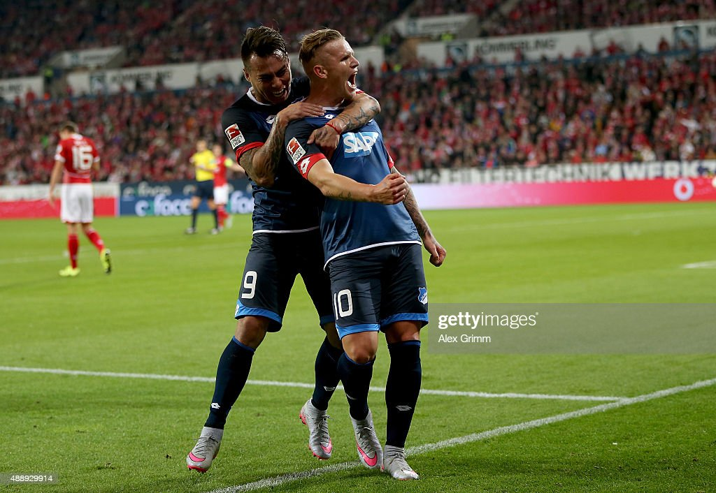 Jonathan Schmid of Hoffenheim celebrates after he scores his team's opening goal during the Bundesliga match between 1 FSV Mainz 05 and 1899...