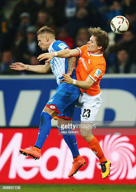 Jonathan Schmid of Hoffenheim is challenged by Florian Jungwirth of Darmstadt during the Bundesliga match between 1899 Hoffenheim and SV Darmstadt 98...