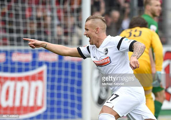 Jonathan Schmid of SC Freiburg celebrates his opening goal during the Bundesliga match between SC Freiburg and FC Augsburg at SchwarzwaldStadium on...