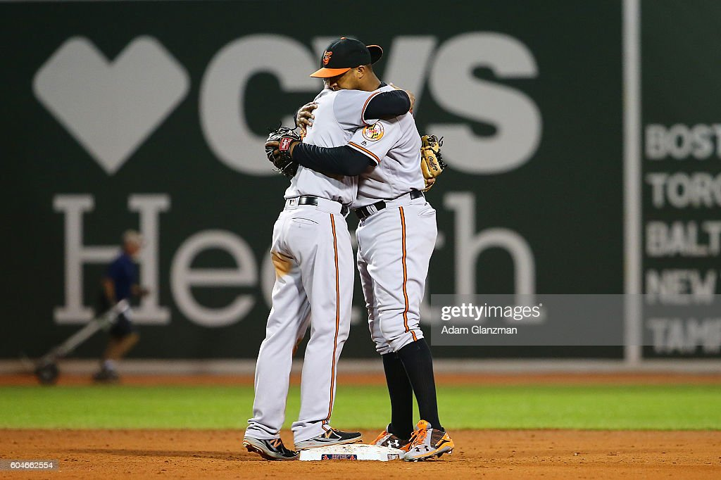 Jonathan Schoop #6 and J.J. Hardy #2 of the Baltimore Orioles embrace after a victory over the Boston Red Sox at Fenway Park on September 13, 2016 in Boston, Massachusetts.
