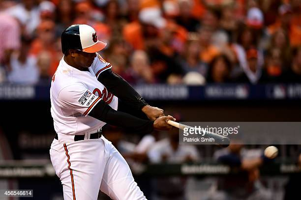 Jonathan Schoop hits a single in the second inning against Max Scherzer of the Detroit Tigers during Game One of the American League Division Series...