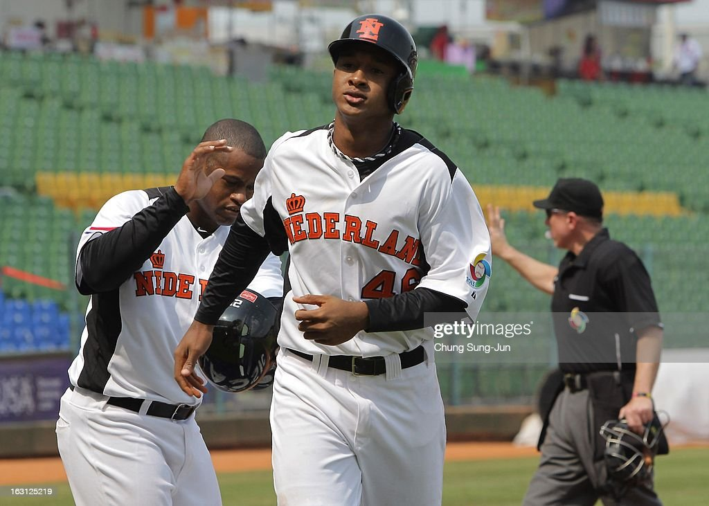 Jonathan Schoop (R) of Netherlands celebrates with Dashenko Ricardo after a two run home run during the World Baseball Classic First Round Group B match between Australia and the Netherlands at Intercontinental Baseball Stadium on March 5, 2013 in Taichung, Taiwan.