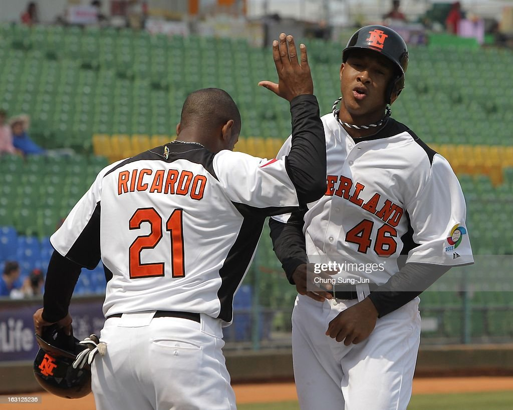 Jonathan Schoop of Netherlands celebrates with Dashenko Ricardo (L) after a two run home run during the World Baseball Classic First Round Group B match between Australia and the Netherlands at Intercontinental Baseball Stadium on March 5, 2013 in Taichung, Taiwan.