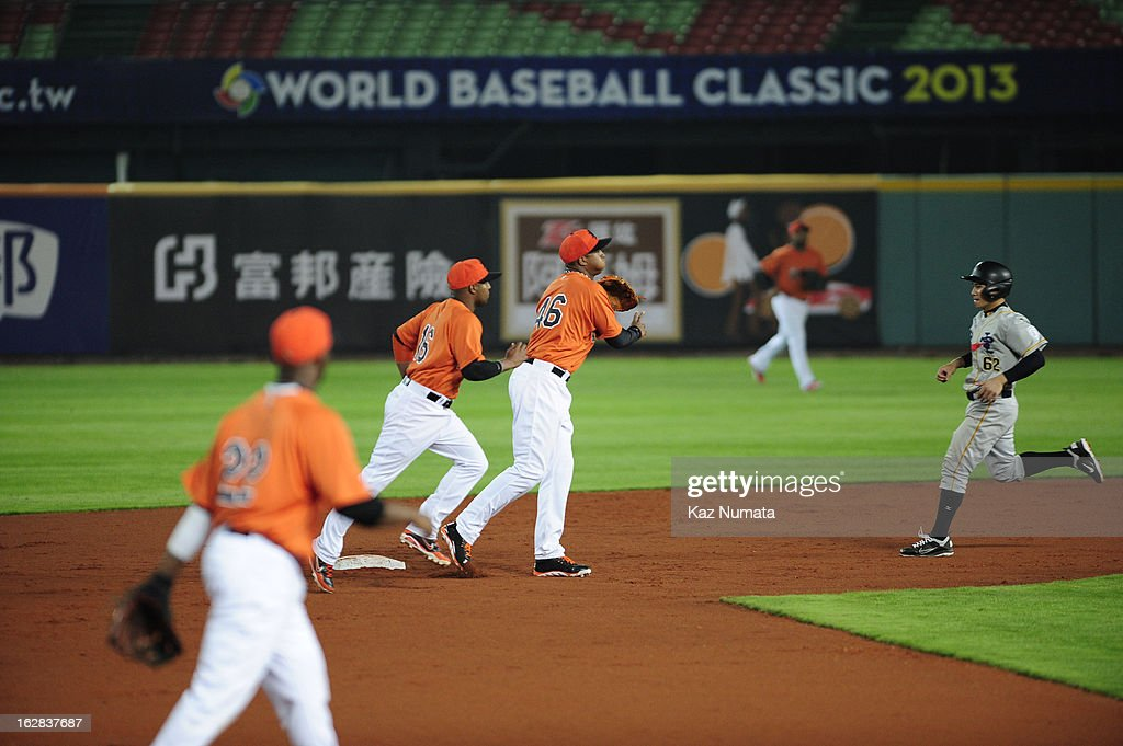 Jonathan Schoop #46 of Team Netherlands turns a double play during the World Baseball Classic exhibition game against the Industrial All-Star Team at Intercontinental Stadium on Tuesday, February 26, 2013 in Taichung, Tawain.