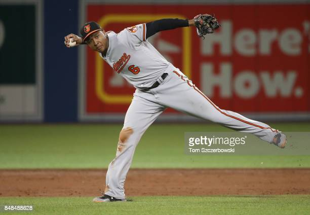 Jonathan Schoop of the Baltimore Orioles cannot throw out Josh Donaldson of the Toronto Blue Jays who hits an infield single in the third inning...