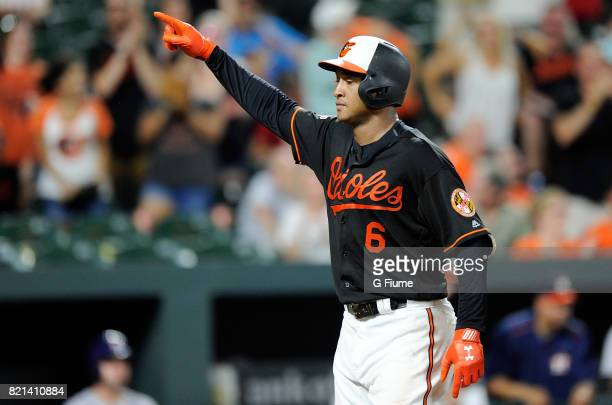 Jonathan Schoop of the Baltimore Orioles celebrates after hitting a threerun home run in the ninth inning against the Houston Astros at Oriole Park...