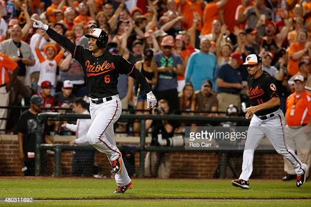 Jonathan Schoop of the Baltimore Orioles celebrates rounding the bases after hitting a walk off home run in the ninth inning to give the Orioles a 32...