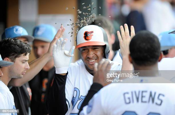 Jonathan Schoop of the Baltimore Orioles celebrates with teammates after hitting a home run in the seventh inning against the St Louis Cardinals at...