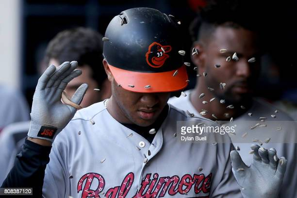 Jonathan Schoop of the Baltimore Orioles celebrates with teammates after hitting a home run in the ninth inning against the Milwaukee Brewers at...