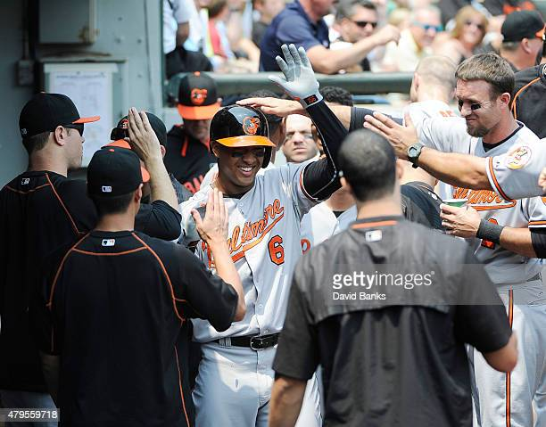 Jonathan Schoop of the Baltimore Orioles is greeted by his teammates after hitting a home run against the Chicago White Sox during the second inning...