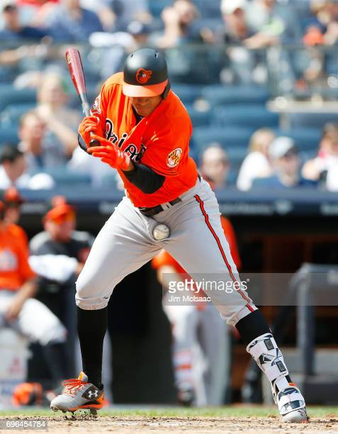 Jonathan Schoop of the Baltimore Orioles is hit a by a pitch against the New York Yankees at Yankee Stadium on April 29 2017 in the Bronx borough of...