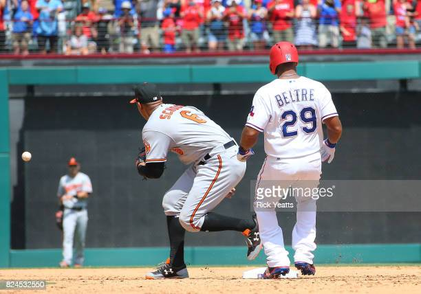 Jonathan Schoop of the Baltimore Orioles is late for the tag on Adrian Beltre of the Texas Rangers after Beltre hit his 3000th MLB career hit in the...