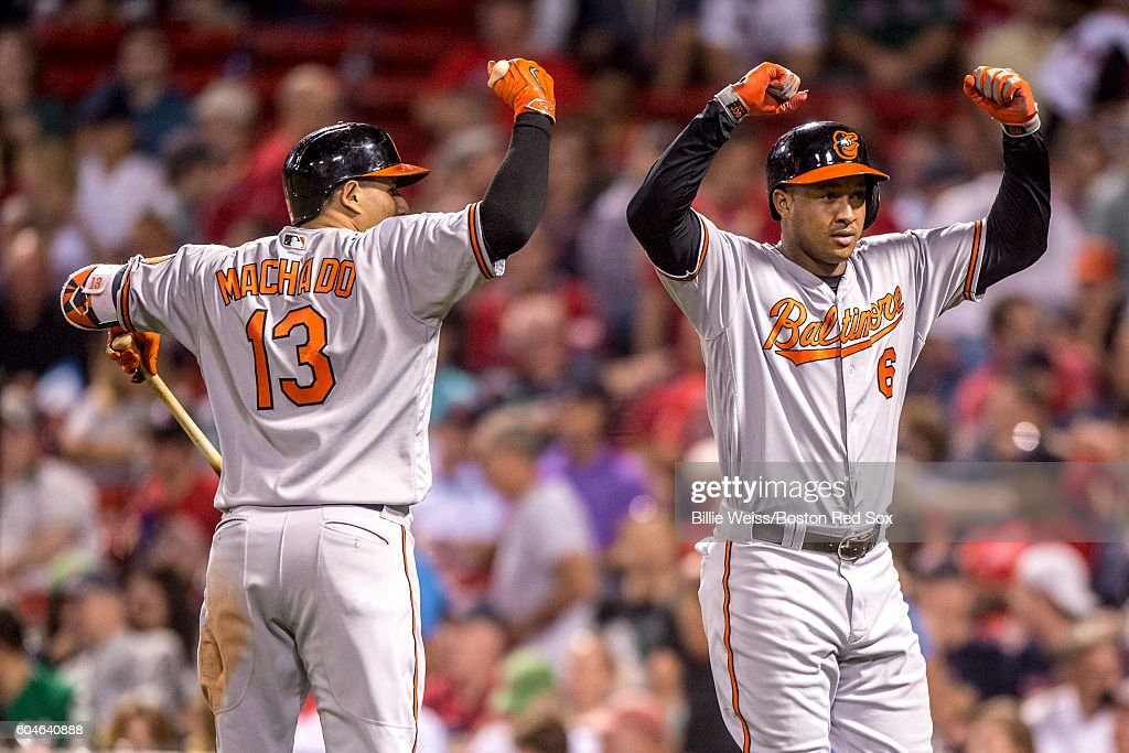 Jonathan Schoop #6 of the Baltimore Orioles reacts with Manny Machado #13 after hitting a solo home run during the ninth inning of a game against the Boston Red Sox on September 13, 2016 at Fenway Park in Boston, Massachusetts.