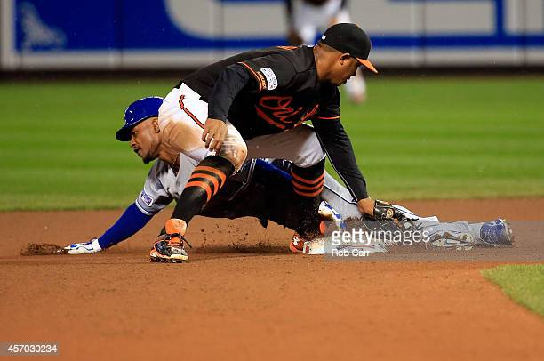 Jonathan Schoop of the Baltimore Orioles tags out Jarrod Dyson of the Kansas City Royals in the seventh inning during Game One of the American League...
