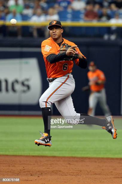 Jonathan Schoop of the Orioles makes the throw over to first base during the MLB regular season game between the Baltimore Orioles and Tampa Bay Rays...