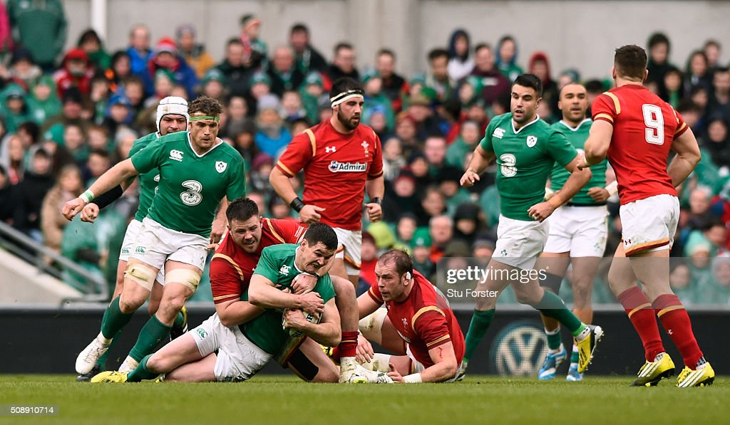 Jonathan Sexton of Ireland is hauled down by Rob Evans of Wales during the RBS Six Nations match between Ireland and Wales at the Aviva Stadium on February 7, 2016 in Dublin, Ireland.