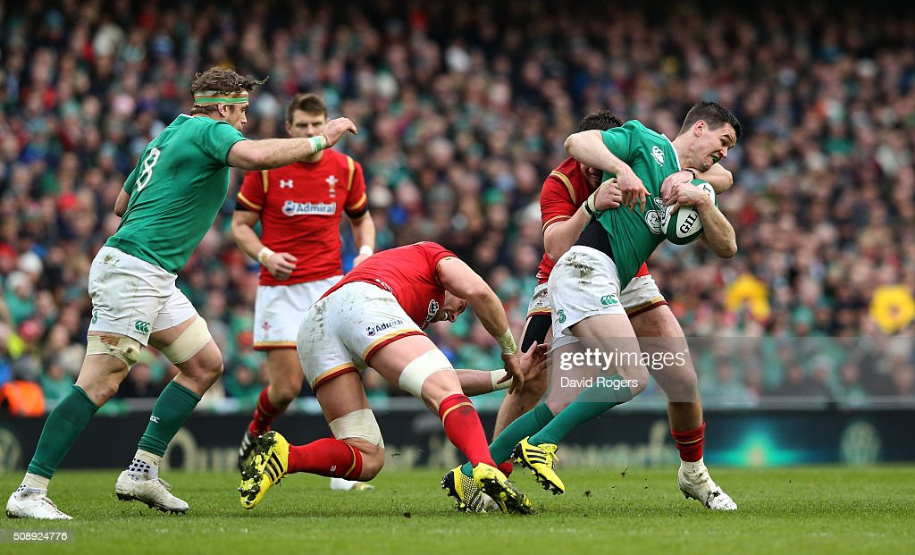 Jonathan Sexton of Ireland is tackled by Alun Wyn Jones and Rob Evans of Wales during the RBS Six Nations match between Ireland and Wales at the Aviva Stadium on February 7, 2016 in Dublin, Ireland.