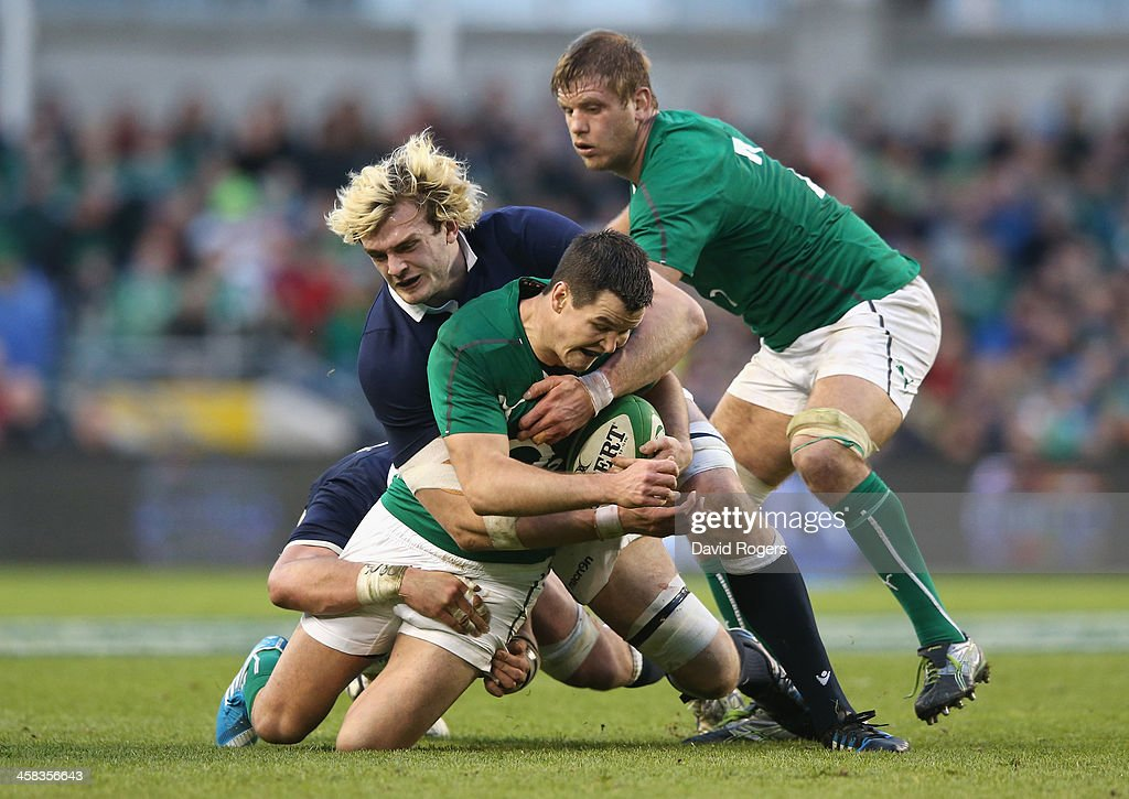Jonathan Sexton of Ireland is tackled by Richie Gray during the RBS Six Nations match between Ireland and Scotland at the Aviva Stadium on February 2, 2014 in Dublin, Ireland.