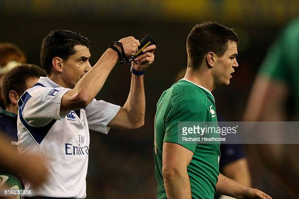 Jonathan Sexton of Ireland leaves the pitch after being shown the yellow card by referee Pascal Gauzere of France during the RBS Six Nations match...