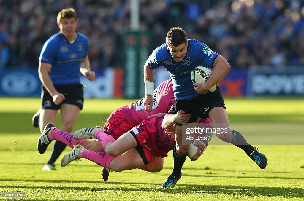 Jonathan Sexton of Leinster is tackled by Will Chudley and Ian Whitten of Exeter Chiefs during the Heineken Cup Pool 5 match between Leinster and Exeter Chiefs at Royal Dublin Society on October 13, 2012 in Dublin, Ireland.