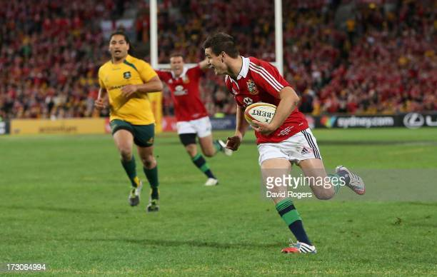 Jonathan Sexton of the Lions breaks clear to score their second try during the International Test match between the Australian Wallabies and British...