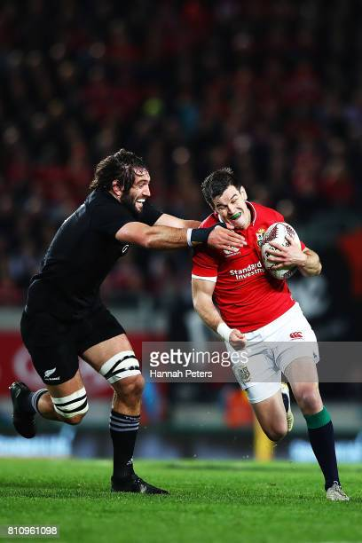 Jonathan Sexton of the Lions makes a break during the Test match between the New Zealand All Blacks and the British Irish Lions at Eden Park on July...