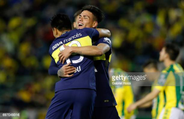 Jonathan Silva of Boca Juniors celebrates with teammate Ricardo Centurión after scoring the fourth goal of his team during a match between Aldosivi...