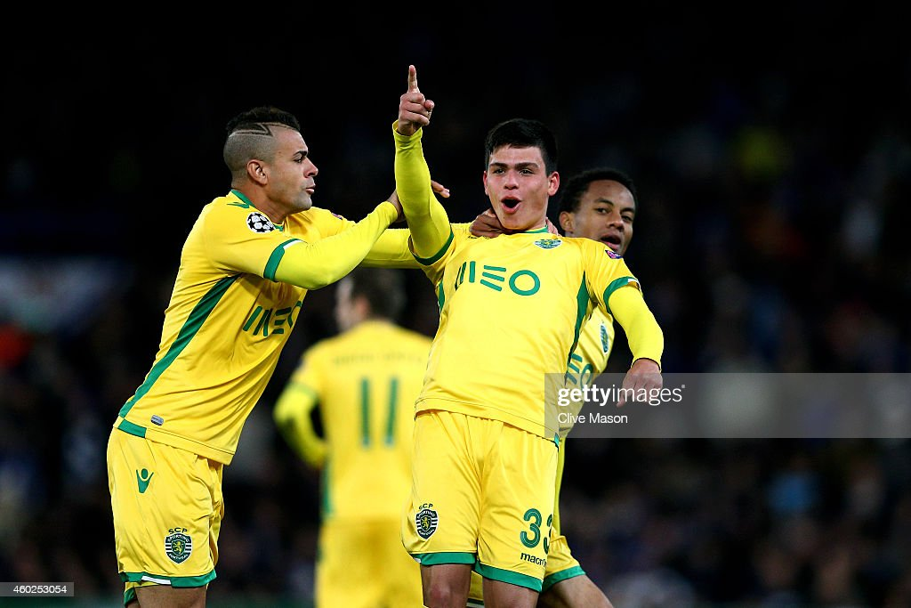 <a gi-track='captionPersonalityLinkClicked' href=/galleries/search?phrase=Jonathan+Silva+-+Soccer+Defender&family=editorial&specificpeople=13791544 ng-click='$event.stopPropagation()'>Jonathan Silva</a> of Sporting Lisbon celebrates with teammates Nascimento Mauricio (L) and Andre Carrillo (R) of Sporting Lisbon scoring his team's first goal during the UEFA Champions League group G match between Chelsea and Sporting Clube de Portugal at Stamford Bridge on December 10, 2014 in London, United Kingdom.