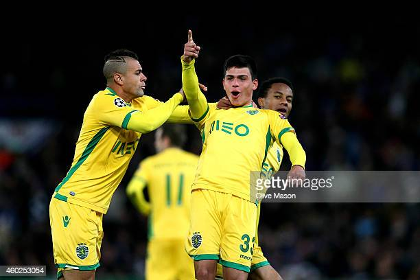 Jonathan Silva of Sporting Lisbon celebrates with teammates Nascimento Mauricio and Andre Carrillo of Sporting Lisbon scoring his team's first goal...