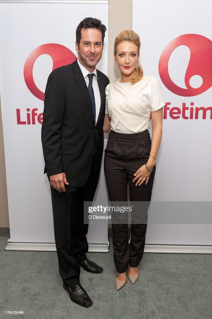Jonathan Silverman (L) and Jennifer Finnigan attend the 'Baby Sellers' premiere at United Nations Headquarters on August 12, 2013 in New York City.