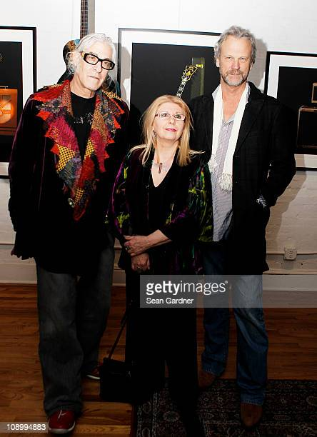 Jonathan Singer Annie Haslam and Peter Blacheay at 'The Art of the Guitar Photography of Jonathan Singer' press preview on February 10 2011 in New...
