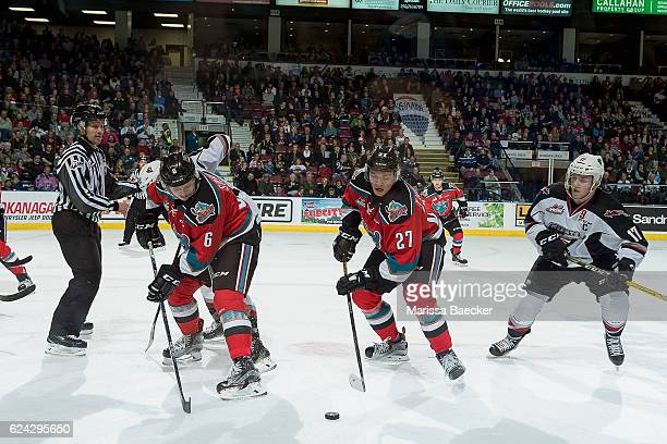 Jonathan Smart back passes the puck to Calvin Thurkauf of the Kelowna Rockets during second period as Tyler Benson of the Vancouver Giants back...
